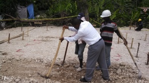 Pastor pitching in to break ground